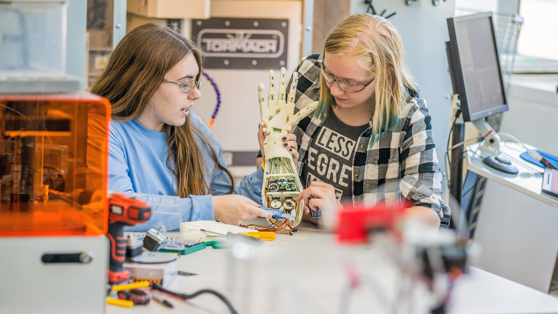 Two female students working on a biomedical engineering project.