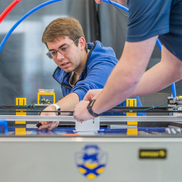 In 2018, JWU students built a robotic air hockey game