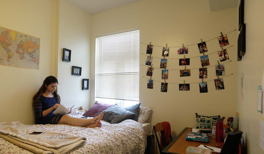 JWU student studying in a residence hall