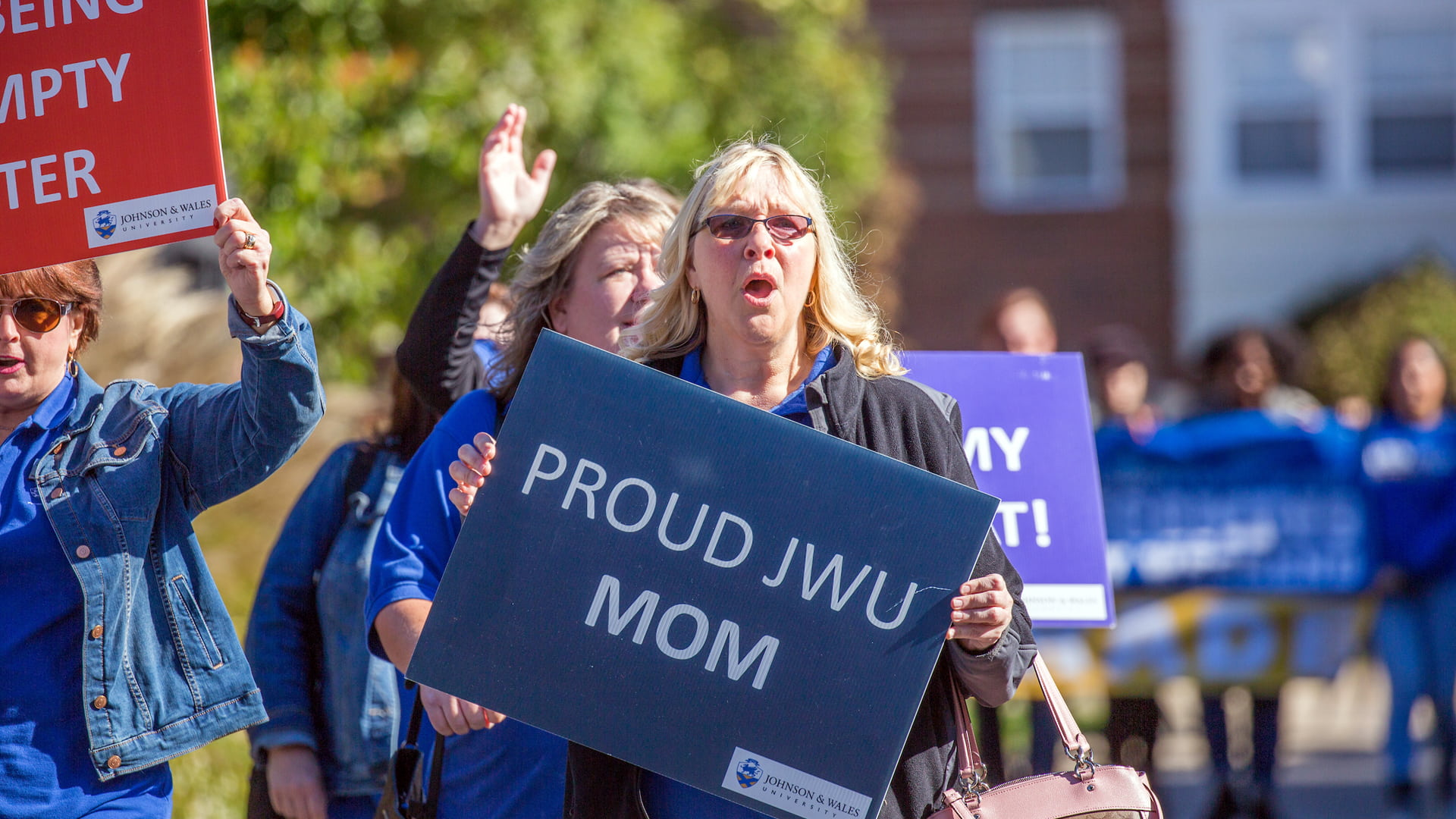 Proud JWU Mom walking in the annual Homecoming and Family Weekend parade.