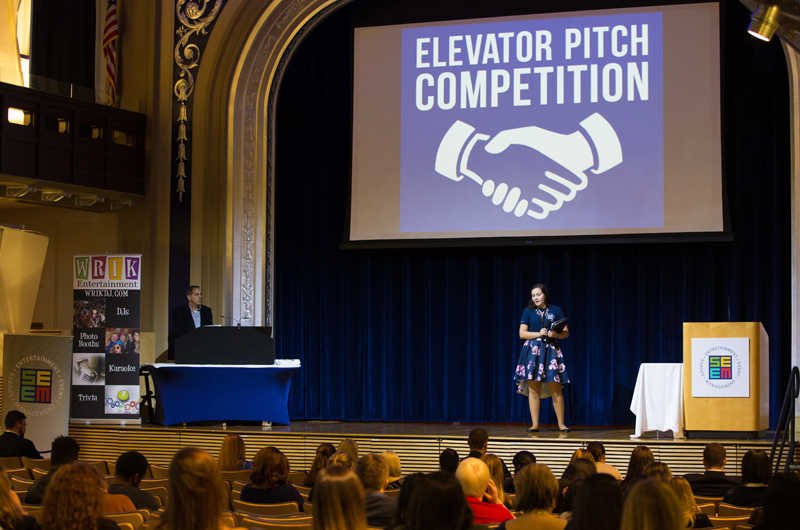 Student planner Paige Zuber '19 kicks off the elevator pitch competition.